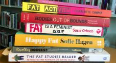 Pile of books on body activism